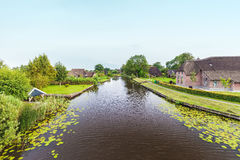 River with old farms in Dutch national park Weerribben Stock Image