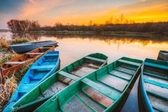 River and old rowing fishing boat at beautiful sunrise at mornin Stock Images
