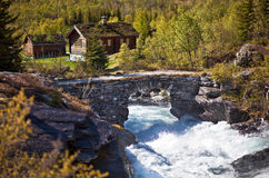 River and old stone bridge. Europe. Scandinavia. Norway. River and old stone bridge Royalty Free Stock Photo