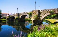 River and old stone bridge at Monforte de Lemos Stock Photography