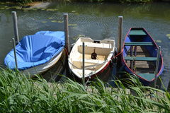 River Oude IJssel with rowing-boats Royalty Free Stock Image
