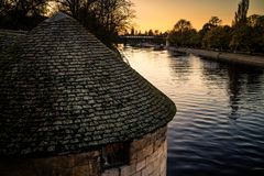 The River Ouse and an Old Tower. The river Ouse in the city of York, England. Taken from the bridge across the river at sunset Royalty Free Stock Photos