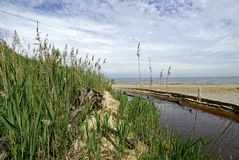 River outlet into Lake Michigan. River outlet draining into Lake Michigan at Dunes State Park, Indiana Stock Photo