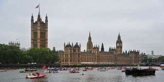 River Pageant June 3rd. A flotilla of boats sail past Houses of Parliament in London on June 3rd during the Royal Pageant, part of the Diamond Jubilee Stock Photography