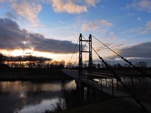 River and footbridge in sunset time, Lithuania Stock Photo