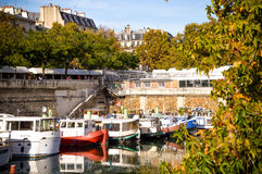River of Paris with boats and buildings summertime. France Royalty Free Stock Photo