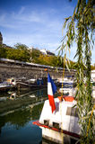 River of Paris with boats and buildings summertime. France Royalty Free Stock Image
