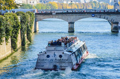 River of Paris with boats and buildings summertime. France Royalty Free Stock Images