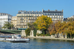 River of Paris with boats and buildings summertime. France Stock Photography