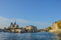 River of Paris with boats and buildings summertime. France Royalty Free Stock Photos