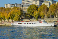 River of Paris with boats and buildings summertime. France Stock Photos