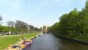 River passenger boat on the canal time lapse. Waterbus river Moika St. Petersburg time Lapse Film Tilt stock video footage