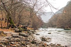 A river passes under a round bridge in zagorohoria greece. This picture shows a river passes under a round bridge in zagorohoria greece Stock Photography
