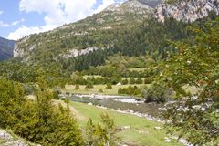 River passing by the mountains in the Pyrenees Royalty Free Stock Images