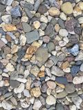 River Pebble Stones in detail. As background or wallpaper Royalty Free Stock Photography