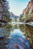 River with pebbles, mountains and picturesque forest. Enchanting and evocative landscape. River with pebbles, mountains and picturesque forest in Corsica in stock image