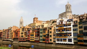 River and picturesque homes in Girona. Day view of river and picturesque homes in Girona. Catalonia, Spain stock video footage