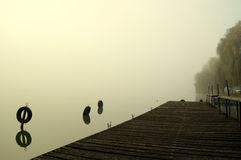 River. Pier on the river in fog Stock Image
