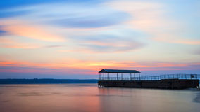 River pier at sunset Stock Photo