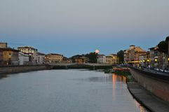 River in Pisa in the evening. Moon rising over the river Stock Photography