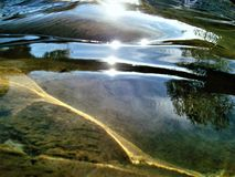 River playng with sun. Sun shine create interesting lights effects on river waters, stones and vegetation reflexe and colours, are like other world images. I stock images