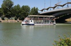 River pleasure boat on the Guadalquivir River in Seville. SEVILLE, SPAIN - JULY 17, 2011: River pleasure boat on the Guadalquivir River in Seville stock photo
