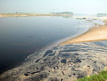 River pollution. The river is clean 20 years ago,but now it is polluted by the factory nearby Royalty Free Stock Images