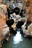 River Potholes. A river carves out unique potholes in the rock on the Panorama Route near the Kruger National Park, South Africa Royalty Free Stock Photo