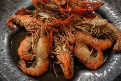 River prawn baked in garlic butter Stock Photos