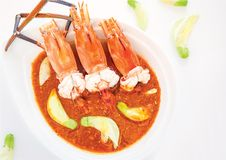 River prawn in sour soup with edible flora and vegetable Royalty Free Stock Photo