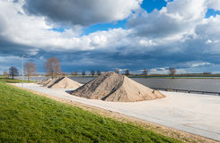 River quay with heaps of sand and gravel Royalty Free Stock Images