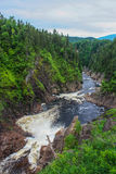 River in quebec canada. Waterfall, river and mountains in quebec canada Royalty Free Stock Images