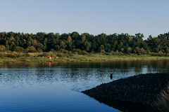 The river with a quiet current and clouds reflected in it, Soz , Gomel, Belarus Stock Photos