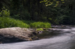 River. Quite fast flowing cold river Royalty Free Stock Images