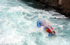 River Rafting. A raft blasting through a wave Royalty Free Stock Photo