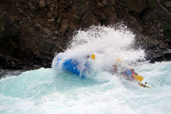 River Rafting. A raft blasting through a wave Royalty Free Stock Photos