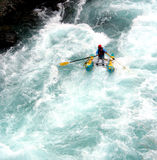 River Rafting. A raft blasting through a wave Royalty Free Stock Image