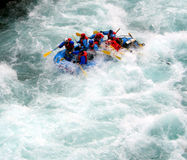 River Rafting. A raft blasting through a wave Stock Photos