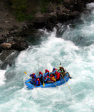 River Rafting. A raft blasting through a wave Stock Photo