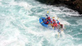 River Rafting. A raft blasting through a wave Stock Images