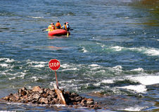 River Rafting. Rafters ignore a stop sign Royalty Free Stock Images
