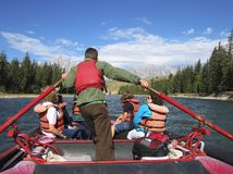 River rafting. A photo of a river rafting trip with the Teton's in the backgroundl stock photo