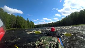 River rafting kayaking. Overcoming water rapids by boat. Rowing paired paddle. Extreme sports. Water sports. Shooting stock footage