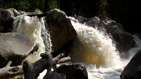 The river, a raging torrent flowing among rocks Stock Images