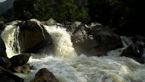 The river, a raging torrent flowing among rocks Royalty Free Stock Image