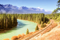 River and railroad. Railway line following the curve of a river Stock Images