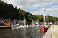 River Rance in Dinan, Normandy, France. Quayside, boats and masts. Stock Photos