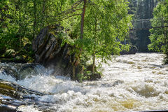 River rapid. And hanging bridge Stock Images