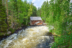 River rapid. And old mill ruin in  Lapland Finland Royalty Free Stock Photography