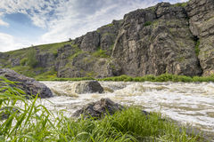 River rapids on a background of rocks summer day. River rapids on a background of rocks on summer day Royalty Free Stock Photo